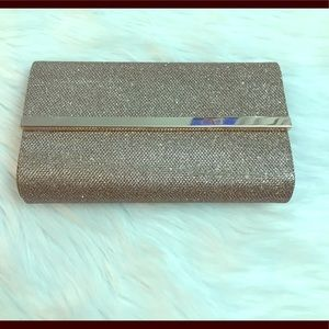 Champagne sparkly clutch bag